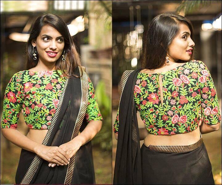 black boat neck floral design blouse